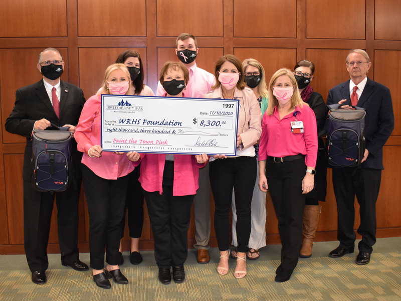 FIRST COMMUNITY BANK RAISES FUNDS FOR BREAST CANCER AWARENESS
